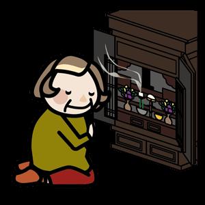 仏壇に手をそえるおばあちゃん